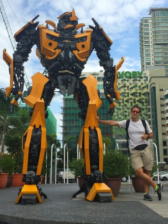 Hanging out with my friend Bumblebee. // Aquí, con mi pata el transformer.